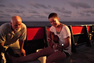 Captain David Murline (left) and Colette Kelly (right) of Stanford University making music in the fading light.