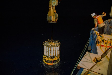 Scripps Research Technician Drew Cole prepares to fix a tag line to the CTD rosette to guide its final arrival on deck.