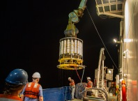 "The final cast of GP15 hovers above the deck of the Roger Revelle as Columbia University's Martin Fleisher retrieves a device called the ""mono-core"" that hangs below the CTD rosette and is used to collect sediment cores."