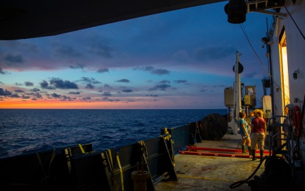 The scientists taking samples from this instrument wrap up their routines for the last time as the horizon lights up.