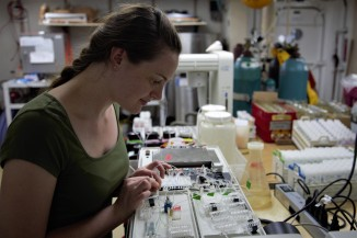Scripps ODF Chemistry Technician Erin Hunt tends to her chemistry in the one of the labs aboard the Roger Revelle.