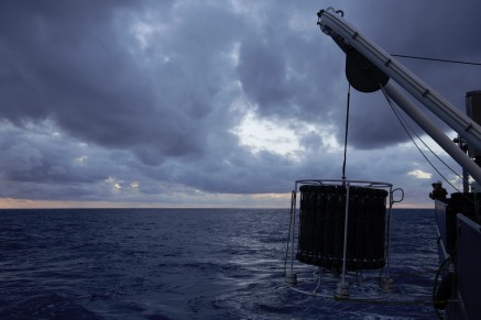 "Even the tropical Pacific can have brooding moments. Here, the trace metal CTD rosette hangs just below the hydraulic ""A-frame"" as it is hauled in."