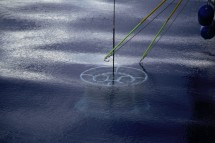 The trace metal CTD rosette lurks beneath the surface while the retrieval team stands at the ready with tag lines.
