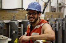 Vinicius Amaral of UCSC works with a smile in the sampling hangar.
