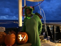David Murline, Captain of the Roger Revelle during GP15, poses with his jack-o-lantern in costume on Halloween.
