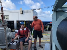 Trace metal CTD rosette technician Kyle McQuiggan gets winch driving instructions from Chief Scientist Greg Cutter of Old Dominion University. This was the only time on GP15 that Cutter did not personally control the trace metal CTD rosette's trip to and from the deep.