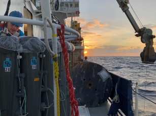 Trace metal CTD rosette technician Kyle McQuiggan on deck at sunrise.