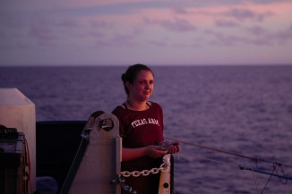 Janelle Stephen of Texas A&M University looking out to sea on GP15's last night before reaching Tahiti, perhaps recalling a time when the journey seemed endless.