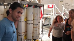 GP15's Joseph Gum of the Scripps Institution of Oceanography's Oceanographic Data Facility (Scripps ODF), explains the CTD Rosette to students from the University of Hawaii.
