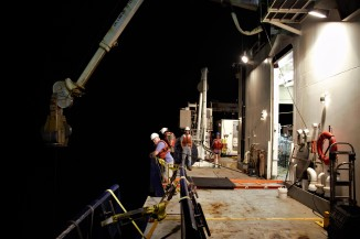 Around 4 a.m. on November 24, members of the GP15 team await the return of the final return of the CTD rosette at the end of the expedition's scientific sampling.