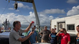 Martin Fleisher of Columbia University shows a sediment core collected during leg one of GP15 to students from the University of Hawaii.