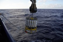 The winch arm of the Roger Revelle hauls in the CTD rosette.